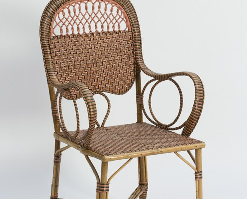 pink rattan armchair