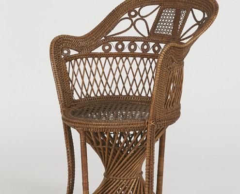 Openwork rattan armchair